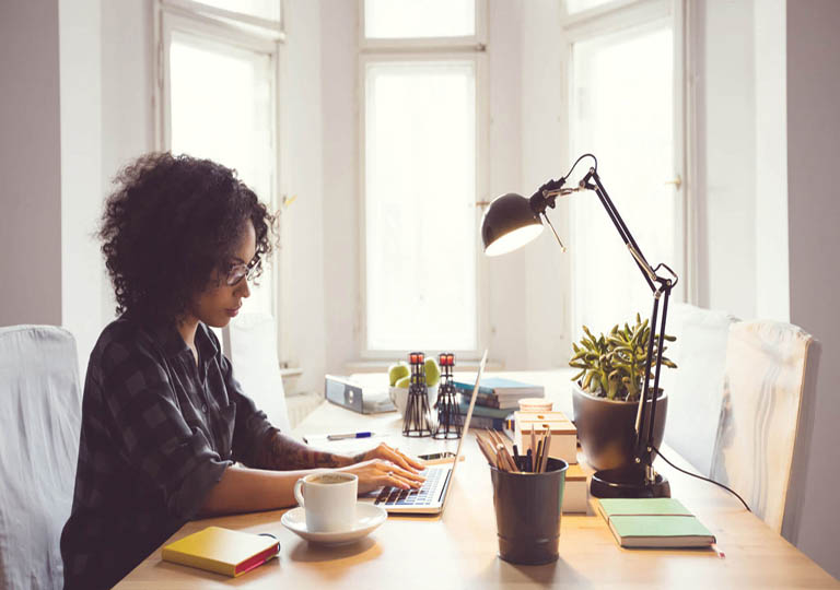 Woman working on laptop at desk