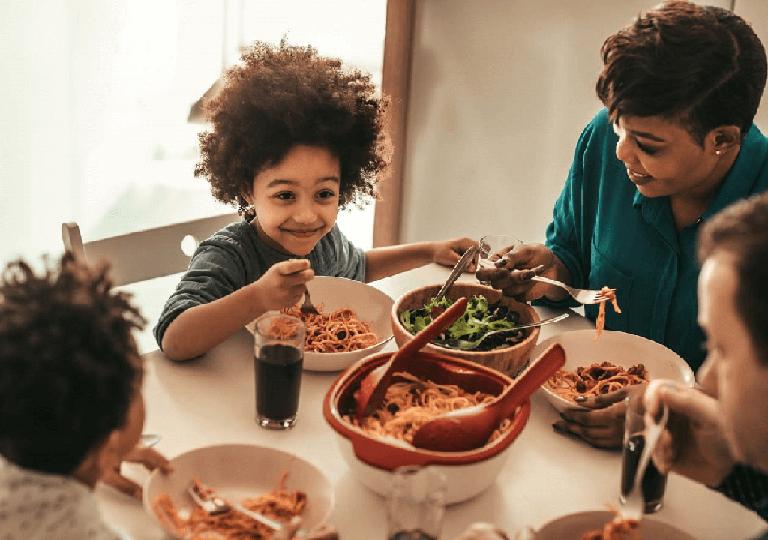 Diverse family eating dinner